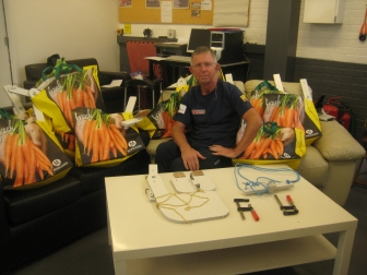 Chris Freeman at the Phoenix Shed with the 18 rudders packed to go to St. Gemma's Hospice