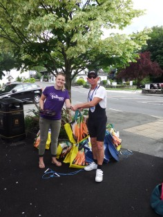 Chris Freeman handing over the rudders to St. Gemma's Hospice at Windermere